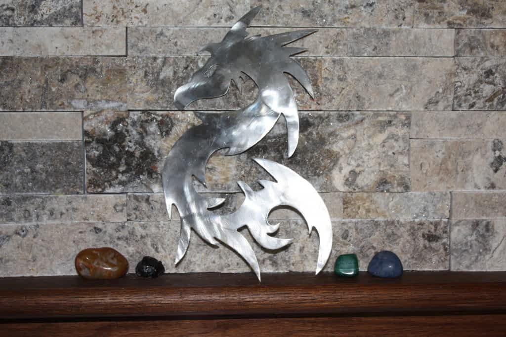 Tribal dragon metal art home decor on shelf